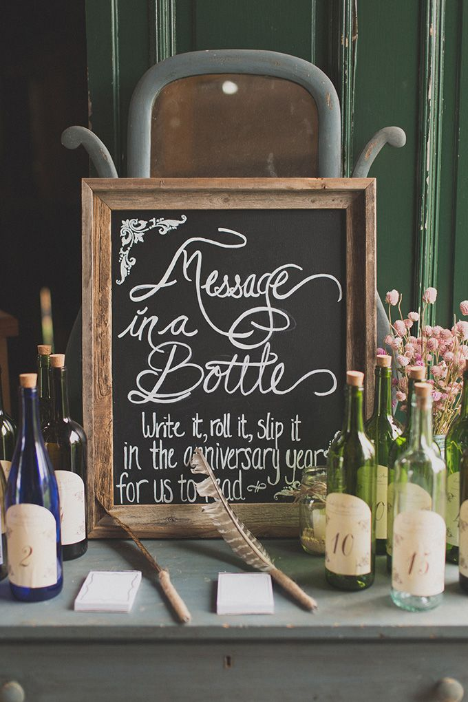 Have your guests write messages for you and yours to open on a specific wedding anniversary! The guest slips their message into the corresponding bottle! How sweet!