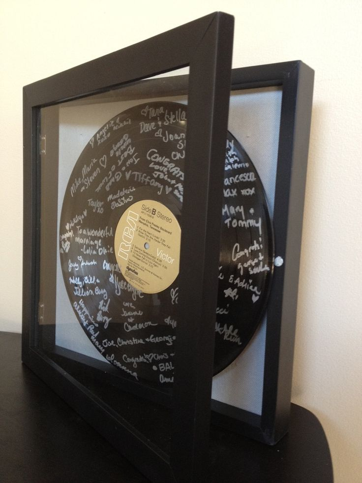 We love love love this idea! Find a vinyl record of your first dance and have guests sign in!