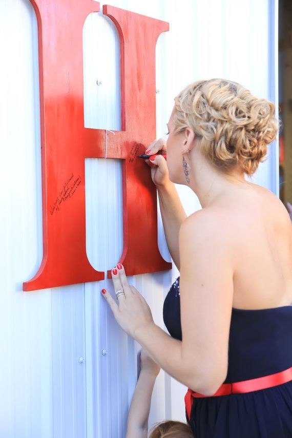 Find a large wooden letter of your shared last name for your guests to sign! It would look great hanging in an entryway as a memory of the day!