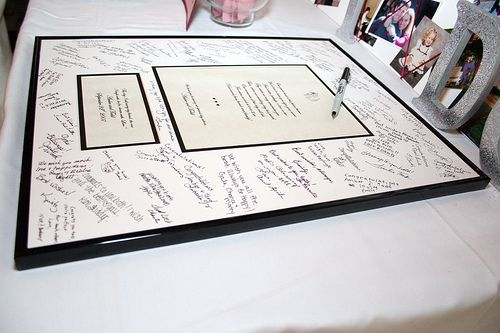 Frame the invitation! What could be a better way to remember the day than the invitation! Have guests sign the matting around it!