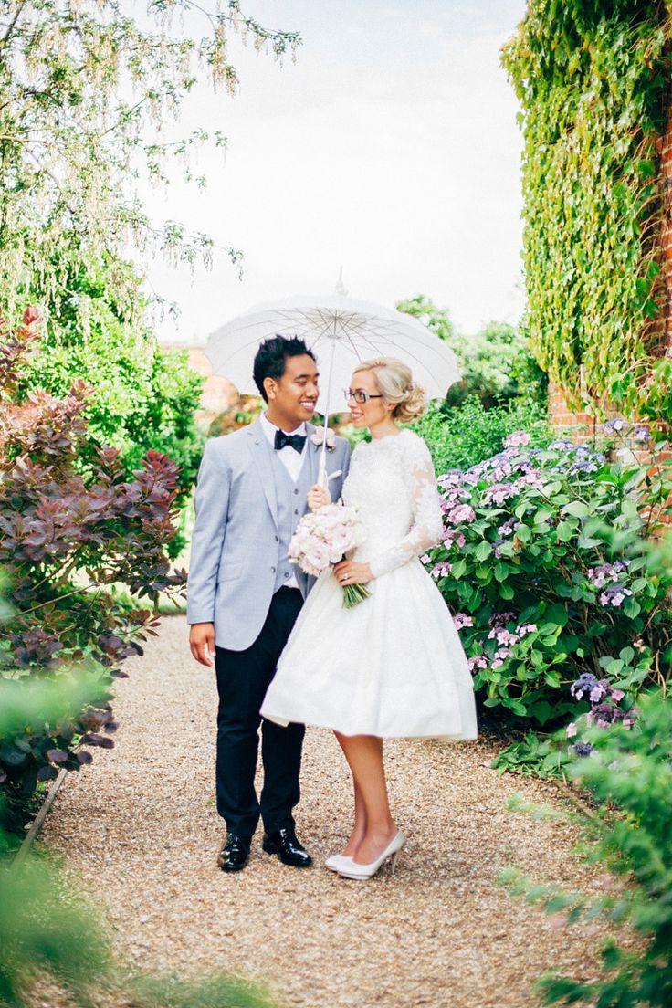 http://www.lovemydress.net/blog/2014/11/bride-in-glasses-50s-tea-length-wedding-dress-braxted-park-essex.html